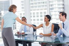 Recruitment consultant shaking hand of an applicant - stock photo