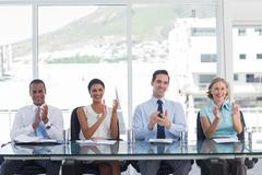 Business people giving applause Stock Photos