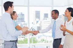Business people clapping their hands - stock photo