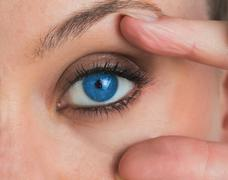 Woman stretching her eye Stock Photos