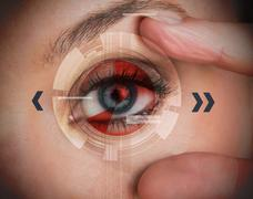Woman stretching her eye for a security authentication Stock Photos