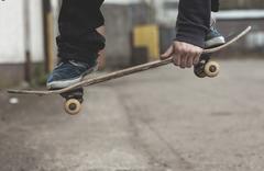 Skater grabbing his board mid air Stock Photos