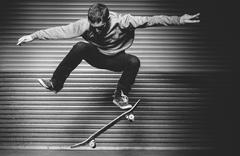Skateboarder in mid ollie Stock Photos