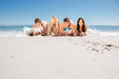 Group of friends on the sand Stock Photos