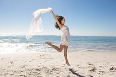 Woman with sarong jumping Stock Photos
