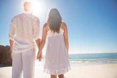 Lovely couple looking at the sea - stock photo