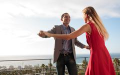 Lovely couple dancing together Stock Photos