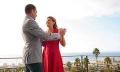 Couple dancing together on the balcony Stock Photos