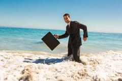Stock Photo of Attractive businessman gesturing in the sea