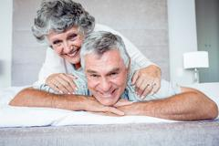 Stock Photo of Mature woman over husband back