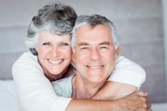Mature woman embracing her husband Stock Photos