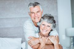 Retired couple posing together on the bed - stock photo