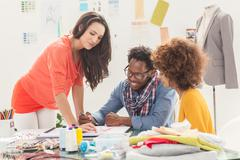 Stock Photo of Group of fashion designers working together