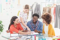 Young fashion designers working together - stock photo