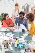 Group of young fashion designers working together - stock photo