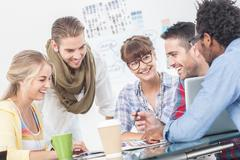 Happy team of creative designers working together - stock photo