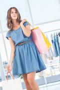 Stock Photo of Pretty brunette holding shopping bags