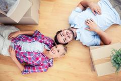 Happy couple lying on the wooden floor Stock Photos