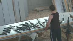 RussianDealerCheckingAK47-32 Stock Footage