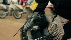 Motorcyclist goes to a motorcycle with a helmet Stock Footage