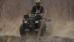 Man rides a quad bike in the mud Stock Footage