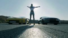 Girl and two cars chase at high speed Stock Footage