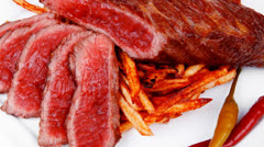 Rare beef on potato chips Stock Footage