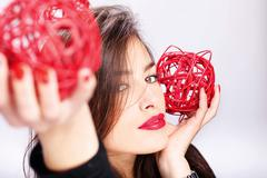 Woman holding two red balls Stock Photos