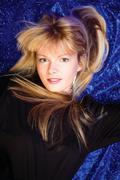 blond girl on blue background - stock photo
