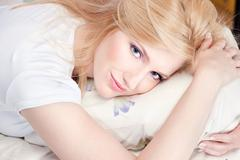 pretty woman on pillow - stock photo