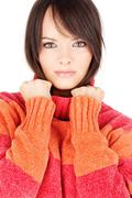 brunette woman in wool sweater - stock photo