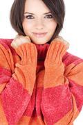 Brunette woman in wool sweater Stock Photos