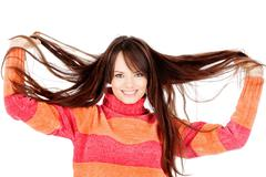 Woman holding her long hair Stock Photos