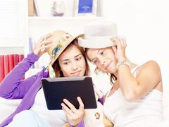 happy teenage girls having fun using touchpad - stock photo