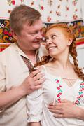 russian couple in national costume - stock photo