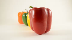 Red, Yellow, Green and Orange Peppers Against White - Dolly Right Stock Footage