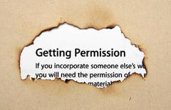 Permission text on paper hole Stock Photos