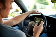 Driving: not paying attention to driving Stock Photos