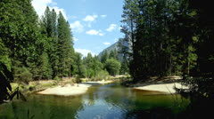 Time lapse of blue skies above a lake at Yosemite National Park Stock Footage