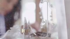 Attractive female shopper gazing into the jewelry cabinet  Stock Footage