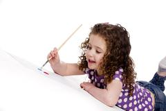Little girl painting a picture Stock Photos