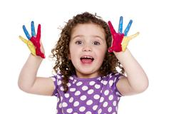 Young girl with painted fingers isolated on a white background Stock Photos