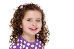 young child smiling at the camera - stock photo