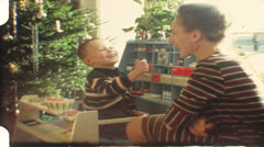 Vintage 8mm film: Christmas, Boy playing corner store, 1960s Stock Footage