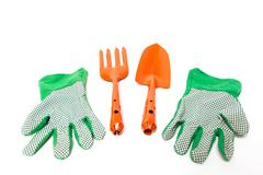 New shiny gardening tools kit including fork, trowel, and gloves isolated on Stock Photos