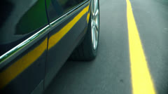 Car in motion - Wheel on the road Stock Footage