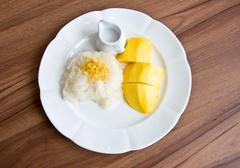 Stricky rice with mango Stock Photos