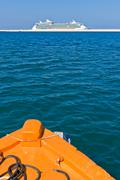 Cruiser seen from a pilot boat Stock Photos