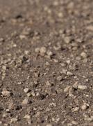 a pile of small stones lying on the ground - stock photo