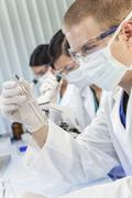 Stock Photo of male scientist or doctor with test tube in laboratory